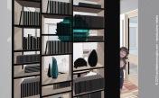 img. 2 - Particolare della libreria posizionata all'ingresso dell'appartamento.